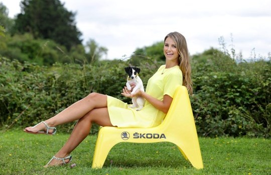 28/7/14***NO REPRO FEE***Caption: ¦KODA is delighted to announce the renewal of its partnership with Dogs Trust as the official vehicle supplier to the charity. The partnership sees ¦KODA adding a ¦KODA Yeti and a ¦KODA Roomster to the charity?s existing fleet of ¦KODA vehicles which will enable the charity to stay on the road helping thousands of stray and abandoned dogs get back on their paws and into loving homes. Pictured at the announcement was Scamp the pup with Vogue Williams, a ¦KODA Yeti driver and a dog lover at the Dogs Trust Dublin Rehoming Centre in Finglas. Pic: Marc O'Sullivan